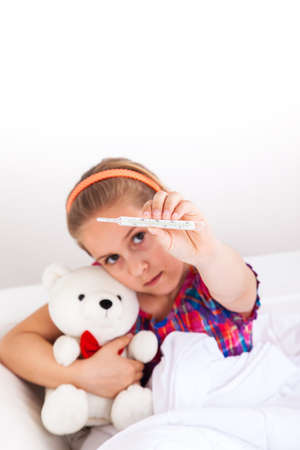 Cute girl doctor with teddy bear Stock Photo - 22795797