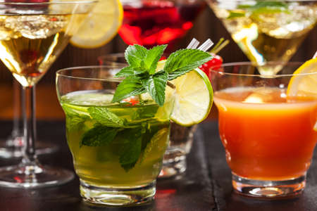 cocktails: Party cocktails and longdrinks garnished with fruits for summer