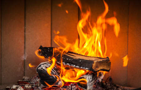 Flames of fire in a fireplace Stock Photo
