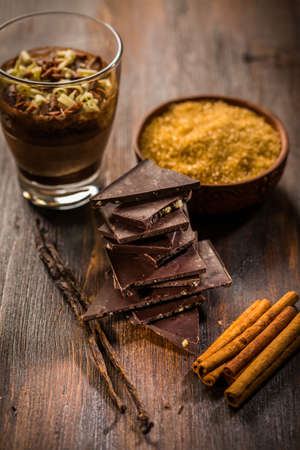 Baking ingredients and spices with chocolate cake in a glass Reklamní fotografie