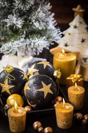 Christmas still life with ornaments and candles on wooden background Stock fotó