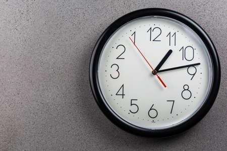 Turn back time - concept of turning clock backwards Stock Photo