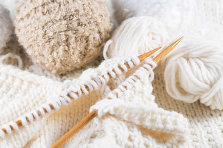 Wool for knitting with knitting needles in bright colors Stock Photo
