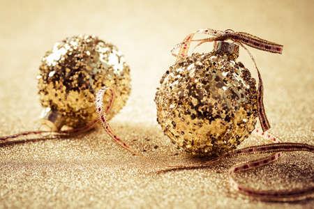 Golden christmas balls on glitter