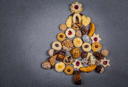 Christmas tree made from different cookies. Stock Photo