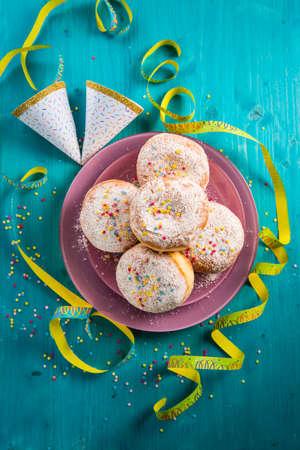 Carnival powdered sugar raised donuts - German Berliner donuts, Krapfen filled with jam