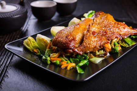 Delicious Peking duck with pak choi and vegetables Stockfoto