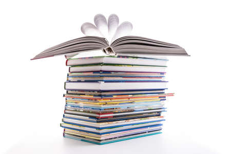 Stack of children's books isolated on white. Concept of learning, education and stody.
