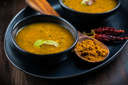 Red lentil curry soup with hot chilli and Thai basil 免版税图像