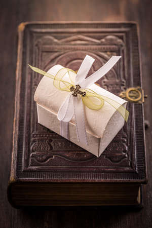 First holy communion - present box on old bible in vintage style Foto de archivo