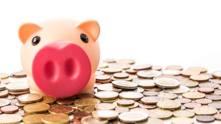 Piggy bank moneybox with euro coins on white background. 版權商用圖片