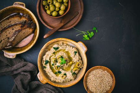 Arabic food: Aubergine paste or dip Baba Ghanoush with olives and sesame seeds