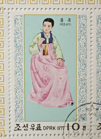 NORTH KOREA - CIRCA 1977  a stamp from North Korea shows image of a woman in traditional North Korean costume, circa 1977
