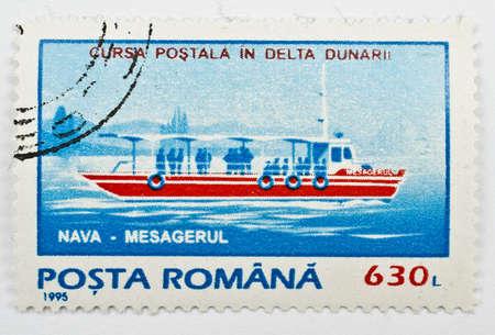ROMANIA - CIRCA 1995  a stamp from Romania shows image of postal ship, circa 1995  Stock Photo