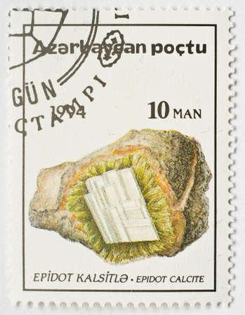 AZERBAIJAN - CIRCA 1994  a stamp from Azerbaijan shows image of the mineral epidote, circa 1994   Stock Photo