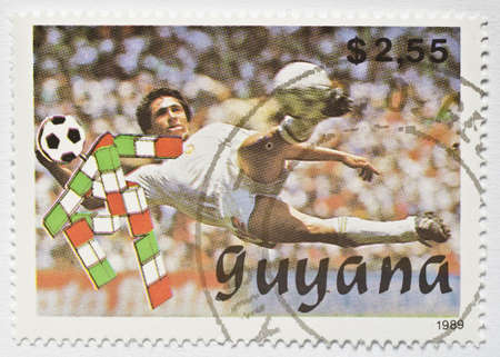 GUYANA - CIRCA 1989  a stamp from Guyana shows image of a soccer player volleying the ball, circa 1989