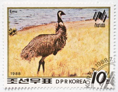 NORTH KOREA - CIRCA 1988  a stamp from North Korea shows an emu, the largest bird native to Australia, and commemorates the 200th anniversary of the first colonial settlement in Australia, circa 1988  Stock Photo