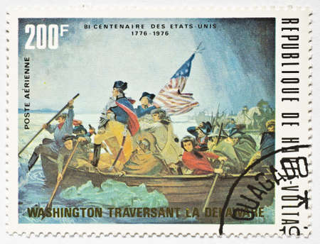 UPPER VOLTA - CIRCA 1976  a stamp from Upper Volta  present day Burkina Faso  shows image of George Washington crossing the Delaware River and commemorates the US bicentennial, circa 1976  Editorial