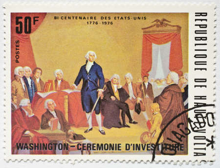 UPPER VOLTA - CIRCA 1976  a stamp from Upper Volta  present day Burkina Faso  shows image commemorating the bicentennial of the USA and shows image of George Washington s Inauguration, circa 1976
