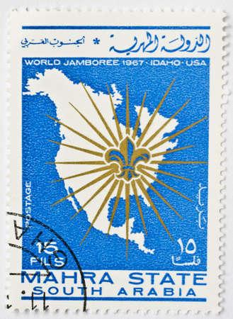 MAHRA SULTANATE - CIRCA 1967  a stamp from Mahra Sultanate  present day Yemen  shows image of North America and commemorates the World Jamboree, circa 1967