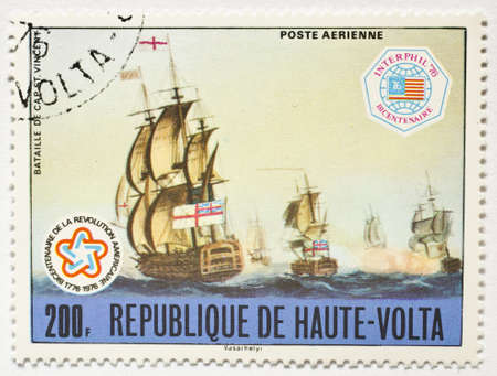 UPPER VOLTA - CIRCA 1976  a stamp from Upper Volta  present day Burkina Faso  shows image of the Battle of Cape St  Vincent and commemorates the US bicentennial, circa 1976