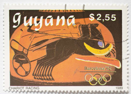 olympiad:  GUYANA - CIRCA 1989  a stamp from Guyana shows image of a chariot racer, circa 1989