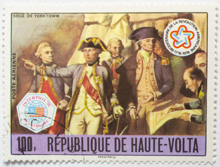 UPPER VOLTA - CIRCA 1976  a stamp from Upper Volta  present day Burkina Faso  commemorates the US bicentennial and shows the Siege of Yorktown, circa 1976  Stock Photo - 17554851