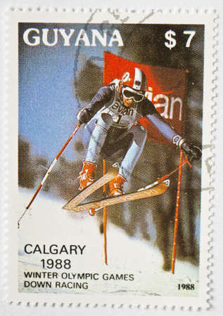 GUYANA - CIRCA 1988  a stamp from Guyana shows image of a downhill skier and commemorates the Calgary 1988 Winter Olympics, circa 1988
