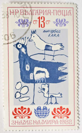 BULGARIA - CIRCA 1982  a stamp from Bulgaria shows a child s drawing of chickens, circa 1982  Stock Photo