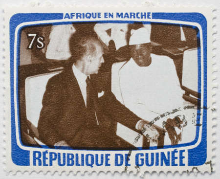 GUINEA - CIRCA 1979  a stamp from Guinea shows image of two dignitaries sitting side by side, from the Africa in Motion series, circa 1979  Editorial