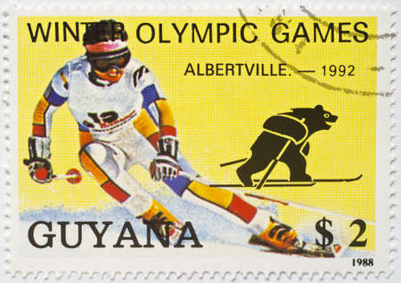 GUYANA - CIRCA 1988  a stamp from Guyana shows image of a downhill skier and commemorates the Albertville 1992 Winter Olympic Games, circa 1988