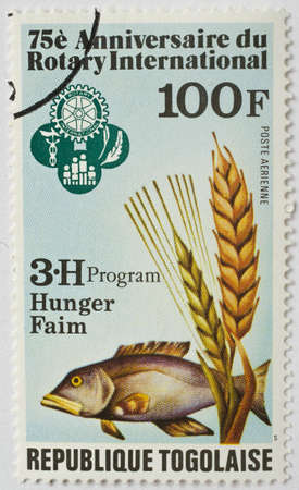 TOGO - CIRCA 1980  a stamp from Togo shows image of a fish and commemorates the food security work of Rotary International, circa 1980  Editorial