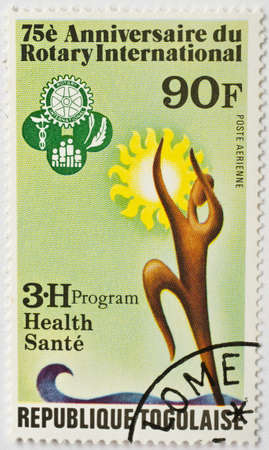 TOGO - CIRCA 1980  a stamp from Togo with Lome postmark shows image commemorating the 75th anniversary of Rotary International  the Rotary Club , the international service club, circa 1980