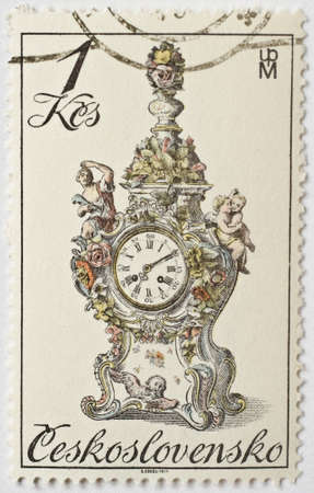 CZECHOSLOVAKIA - CIRCA 1979  a stamp from Czechoslovakia shows image of an ornate granddaughter clock, circa 1979  Editorial