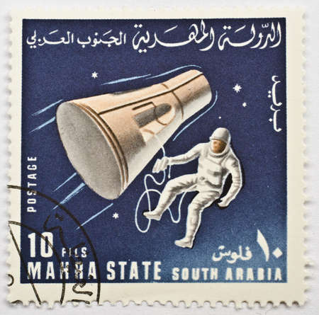 MAHRA SULTANATE - CIRCA 1967  A stamp from Mahra Sultanate  present day Yemen  shows image of an astronaut and a space probe, possibly commerorating the Gemini Project, circa 1967