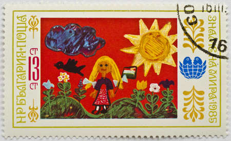 BULGARIA - CIRCA 1985  A stamp from Bulgaria shows a drawing by a child of a person in the countryside, circa 1985 Stock Photo