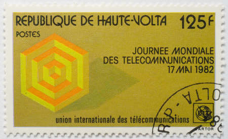 UPPER VOLTA - CIRCA 1982  A stamp from Upper Volta  present day Burkina Faso  shows image commemorating International Telecommunications Day, May 17, circa 1982