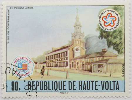 UPPER VOLTA - CIRCA 1976  A stamp from Upper Volta  present day Burkina Faso  shows image commemorating the Siege of the Government of Pennsylvania and commemorates the US bicentennial, circa 1976