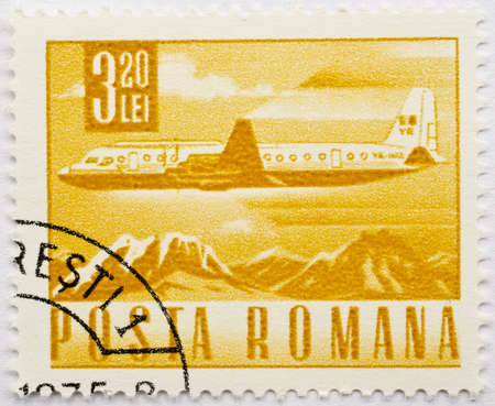 ROMANIA - CIRCA 1975  A stamp from Romania shows image of an airplane flying over mountains, circa 1975