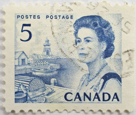 CANADA - CIRCA 1970  a blue 5 cent stamp from Canada shows image of Queen Elizabeth II and a fishing port, circa 1970  Editorial