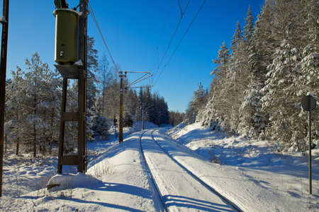 snowlandscape: Railroad in snowlandscape Stock Photo