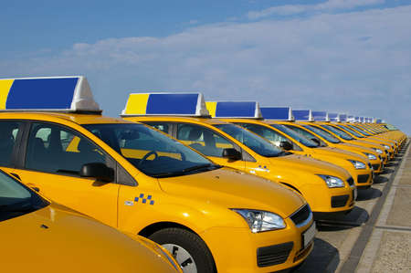 A lot of yellow taxi cars on parking