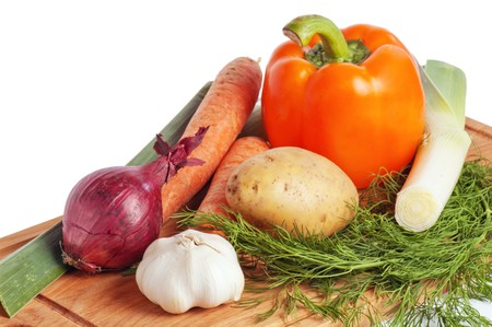 vegetables on a wooden kitchen board photo