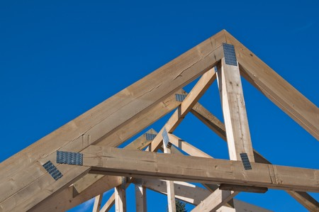 rafters: Wooden rafters against the blue sky Stock Photo