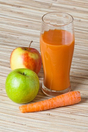 Carrots, apple and juice photo