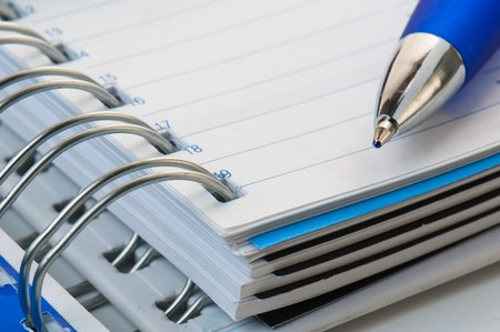 pencil on opened a notebook Stock Photo - 7684725