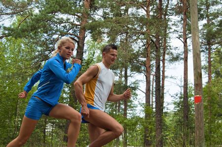 Sportsmen. The young man and the girl Stock Photo