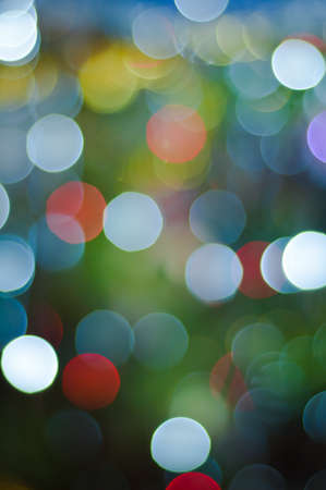 Defocused image of shone bulbs on a christmas-tree photo