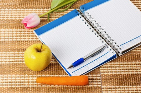Open notebook, yellow apple and pencil Stock Photo - 8632524