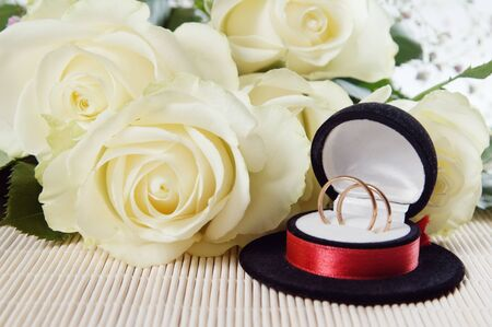 The invitation to wedding. A bunch of flowers and wedding rings photo